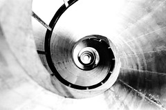 Corkscrew (Jeff Heurteur) Tags: blackandwhite bw white abstract black paris france art lines architecture stairs analog 35mm canon french spiral blackwhite noir noiretblanc kodak curves nb minimal staircase minimalism blanc canon300v kodaktmax400 argentique noirblanc panthon abstrait minimalisme linescurves analogique artisticblur