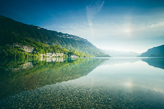 Just a mirror for the sun (Maximecreative) Tags: longexposure blue sky lake mountains reflection green water clouds switzerland daylight spring quiet brienzersee stones low calm transparency serene shallow samyang leefilters bigstopper