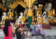Sweet Burmese family portrait at Shwedagon (Bn) Tags: myanmar birma burma yangon rangoon former capitol street candid monk bikes taxi city six million people buddhist temple botataung pagoda botahtaung gautama buddha hair 2500 years old religions locals 40m high seaport dazzling road car gold kyats umbrella sunshine fietstaxi gate entree hollow destroyed rebuild colonial overwhelmed infrastructure slums pilgrims buddism traffic cycling shwedagonpagoda 2600years 99m group portrait family smartphone snapshot burmese 50faves topf50 zen