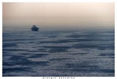 nave in arrivo (Giorgio Serodine) Tags: canon mare nave riflessi trieste controluce golfo orizzonte teleobiettivo dalontano
