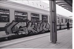 0005 (coloredsteel) Tags: street leica white black self 35mm graffiti stand kodak iso400 f14 trix rodinal developed m6 nokton trainspotting ulm voigtlnder developing trainwriting
