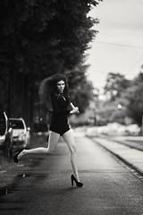 Alissa (graigue | http://www.graigue.com) Tags: street girls bw woman monochrome jump legs longhair run strasbourg alsace mouvement graiguecom