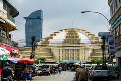 Economic Contrasts (Payam Mazloum) Tags: travel tower beautiful shopping photography gold cambodia market central bank growth backpacking bazaar economy phnom phen