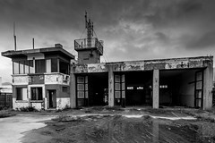 Kai Tak Airport - Firestation (Keith Mulcahy) Tags: blackandwhite buildings hongkong landscapes airport firestation kowloon derelict kaitak canon1635mm hongkongoldairport canon5dmk3 keithmulcahy blackcygnusphotography ppa7a0 ppd56c