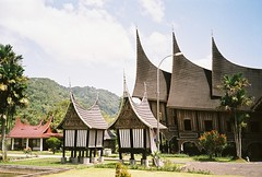 (yttria.ariwahjoedi) Tags: camera blue roof sky house west film architecture sumatra indonesia point asia shoot pointy shot riva minolta zoom south traditional culture sunny east 150 shape ethnic complex padang sumatera bagonjong