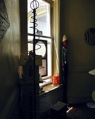 fence post art (omoo) Tags: newyorkcity sunlight window apartment interior westvillage diningroom greenwichvillage woodsculpture dscn8634 fencepostsculpture fencepostart gothiccottagebirdfeeder topiaryframe orangepaperlamp