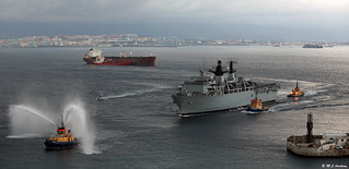 Royal Navy's HMS Bulwark (L15) entering Gibraltar Harbour escorted via the North Mole with General Sir James Dutton, Governor of Gibraltar-Designate on board