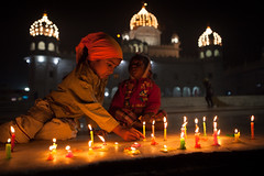 Candles, Patiala (Marji Lang Photography) Tags: lighting light people india festival kids night children temple happy photography lights candles candle child nightshot indian joy beautifullight celebration sikh gurdwara punjab diwali celebrate gurudwara sikhism punjabi patiala diwalifestival gurdwaradukhnivaransahib marjilang vision:clouds=0547 vision:outdoor=0695 vision:sky=0856 vision:car=0503