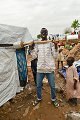 A male IDP works out at the UN PoC camp using makeshift weights. (tommcshanephotography) Tags: africa travel war southsudan refugees un unitednations conflict wtn dinka unhouse juba rivernile neur humanitariancrises tommcshanephotography levwood levisonwood walkthenile
