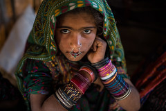 Dhaneta Jat tribe little girl in great rann of kutch (anthony pappone photography) Tags: travel india colors girl silver colours handmade muslim earring piercing ring rings tribes littlegirl nomad asie nosering cloth ethnic indi indien nomads indi yat islamic gujarat inde ethnology azi nomade nomadic indland noserings kutch bhuj  jat etnic greatrannofkutch indija  etnia handembroidered ethnie dhanetajat dhaneta   jattpeople jatttribe earringnose earringjatjat jattribe desertkutch kutchtribes anthropologye dhanetajattribe ahirtribe