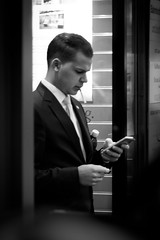 (suissidle) Tags: street city portrait businessman break cigarette candid zurich young smoking suit busy elegant yuppie texting