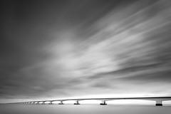 Zeeland big sky (frank_w_aus_l) Tags: longexposure bridge sky bw seascape abstract water netherlands monochrome architecture clouds nikon infinity wideangle zeeland minimal nl niederlande zeelandbrug colijnsplaat d810
