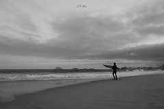 Let's surf (Jos Eduardo Nucci) Tags: ocean life travel winter sunset sea sky blackandwhite bw favorite sunlight storm beach nature silhouette riodejaneiro fun photography grey islands evening blackwhite sand nikon flickr alone loneliness br rj cloudy shots outdoor surfer board culture philosophy explore foam tropical brazilian minimalism minimalismo 28300mm carioca ipanema copacabanabeach wonderfulcity joseduardonucci
