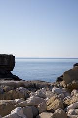 Miracoli della fotografia  (look, there is a dolphin) (Shooting in RAW) Tags: sea panorama canon eos mediterraneo mare blu natura pietre sole acqua paesaggi salento puglia paesaggio delfino scogli scogliera litoranea mareadriatico flickrestrellas