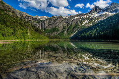 Avalanche Lake (Paul Domsten) Tags: mountain lake snow water reflections river landscape waterfall montana outdoor mountainside glaciernationalpark flathead goingtothesunroad avalanchelake rokinon14mm28