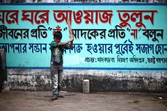 No DRUGS, only CRICKET (N A Y E E M) Tags: arif boy neighbour morning street norahmedroad chittagong bangladesh carwindow candid portrait message cricket
