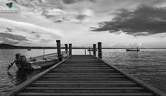 Punta San Vigilio - Garda (Elisa.95) Tags: wood sky italy white lake black water clouds pier boat nikon garda fishermen reflexes