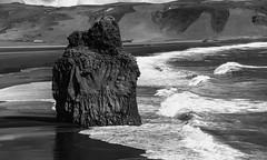 the petrified troll in waiting (lunaryuna) Tags: bw seascape mountains beach monochrome season landscape coast iceland spring surf lunaryuna monoliths seastacks northatlantic reynisdrangar vikimyrdal southiceland columnarbasalt petrifiedtroll blackmwhite capedyrholaey blackvolcanicbeach