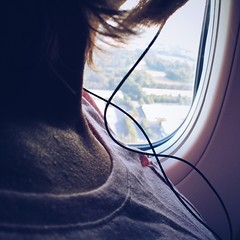 Crisscross (backbeatb00gie) Tags: abstract wife headphones view window vacation airplane flying