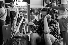 Travel 5/52 (Go-tea) Tags: street city travel portrait people urban bw white man black france station train pen canon project eos 50mm reading book hall blackwhite focus waiting 5 seat young tshirt indoor luggage passengers inside toulouse bnw travelers 52 100d 52project