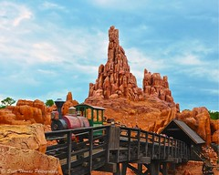 Riding Passion (Scottwdw) Tags: travel bridge red vacation motion blur clouds train outdoors wooden orlando movement nikon rocks ride florida engine overcast waltdisneyworld magickingdom bigthundermountainrailroad oldwest btmrr d700 scottthomasphotography afsnikkor28300mmf3556gedvr