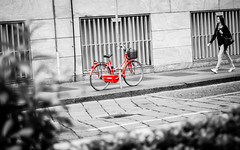 One day she will notice me (shiny red bike) (Andrey Gavrish) Tags: street bw italy white black milan girl lady walking nikon italia milano lombardy d300 redbike