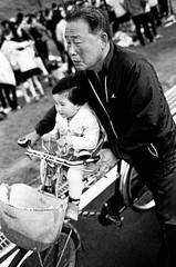 ZI-201305-B-004-14c (model337) Tags: street family bw film child basket bikes bicycles zeissikon pushed southkorea kodaktmax400 lanternfestival gyeongju buddhasbirthday 4001600 zeissbiogon35mmf2