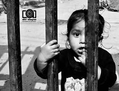 The million dollar one eyed expression... (Invictus ()) Tags: portrait eye girl childhood blackwhite mankind olddhaka flickraward tilldeathchildiam