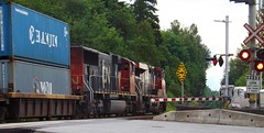 CN eastbound mixed freight (Derek.Nelson.) Tags: cn cnr canadiannational cnrail es44dc sd75i