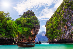 Long boat, rocks on Koh Hong in Krabi, Thailand (Patrick Foto ;)) Tags: ocean trip travel blue sea summer sky cliff cloud sun sunlight mountain seascape tree green tourism beach nature water beautiful beauty grass rock stone landscape thailand island bay coast boat sand scenery asia long paradise day view tail hill wave sunny nobody lagoon thai tropical destination tropic coastline krabi andaman