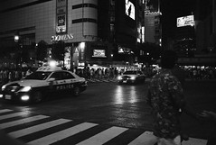 Sirens of Shibuya (banpreso) Tags: street bw film car japan night zeiss 35mm tokyo dangerous asia gun shibuya police delta line contax busy 400 zebra intersection t3 emergency ilford siren speeding blazing