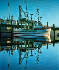 Reflected twice (Ian@NZFlickr) Tags: morning reflection magazine boat still fishing harbour reflected nz otago dunedin f11