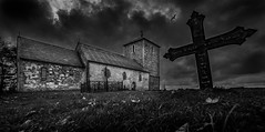 The Burial Cross (Tore Thiis Fjeld) Tags: autumn sky bw bird church graveyard norway clouds contrast nikon october mood cross dramatic atmosphere hordaland d800 midieval avaldsnes churchofavaldsnes samyang