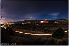 Garden Of The Gods at Night (ctofcsco (mostly offline until Aug)) Tags: blue sky usa seascape mountains classic bulb night america canon stars landscape lights landscapes colorado long exposure cityscape unitedstates rocky gardenofthegods spotlight fisheye timeexposure explore coloradosprings co northamerica moonlight 5d rockymountains lighttrails usm scape pikespeak f4l eos5d cheyennemountain 5dclassic 5dmark1 5dmarki 815mm ef815mmf4lfisheyeusm eos5dclassic ef815mm inspiringcreativeminds vision:sunset=0596 vision:outdoor=0898 vision:clouds=099 vision:sk