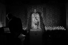 Untitled (ajkpix) Tags: california street urban blackandwhite bw man church blackwhite candles catholic spanish priest sanjuancapistrano blackwhitephotos padrejuniperoserra scattidistrada giovannidacapistrano missionofsanjuancapistarno catholicsfranciscanorder fathersjosébaronavicentefustérandvicentepascualoliva