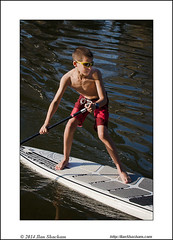 Young boy paddling (Ilan Shacham) Tags: boy wet water sport river landscape fun outdoors israel boat telaviv stream surf child view exercise scenic paddle son adventure health activity float paddling sup yarkon standuppaddleboarding standuppaddleboard standuppaddling standuppaddlesurfer standuppaddler