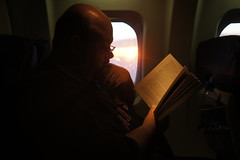 Hywel gets a few pages read on the short flight