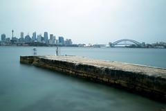 Sydney Harbour (neco.w) Tags: ocean city bridge blue sea house fish blur building water rock buildings pier fishing fisherman opera rocks long exposure slow harbour sydney rocky shutter fisherwoman