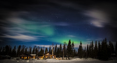 Trace of a Northern Light (Timo Horstschfer) Tags: longexposure travel trees winter vacation sky holiday snow color art nature night clouds forest canon stars landscape geotagged photography photo europe sweden lappland aurora scandinavia kiruna borealis magiclantern northernlight campalta