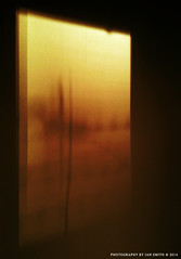 Sunset Shadows (Ian Smith (Studio72)) Tags: sunset red orange abstract silhouette yellow wall warm shadows framed razorwire studio72 littlephoto samsunggalaxyace2