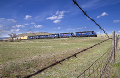 Seis Flares (MRL 390) Tags: railroad train fence barbedwire logan freight mrl freighttrain sd45 montanaraillink loganmontana manifestfreight emdsd45 mrl2ndsubdivision mrlsd452 montanaraillink2ndsubdivision