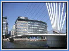 Salford Quays 10. Bridge to the BBC. jpg (Margaret Edge the bee girl) Tags: bridge blue windows sky sun white water architecture modern buildings manchester outdoors grey salfordquays cables bbc supports mediacentre bluepeter