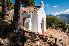 Ermita Del Calvario, Sierra Mijas (Keith in Exeter) Tags: travel trees mountain building tourism pine architecture forest fence landscape spain woods worship europe european catholic view outdoor chapel andalucia sierra resting hermitage andalusia mijas andalusian ermita calvary calvario andalucian
