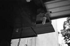 Shade II (klolam) Tags: old blackandwhite blur film water monochrome rain weather 35mm outdoors hongkong lomography angle pentax bokeh perspective analogue pentaxmesuper hongkongisland sheungwan oldhongkong