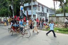 H504_3401 (bandashing) Tags: street red england tree men manchester shrine hill crowd logs rickshaw sylhet bangladesh carry socialdocumentary followers mazar mystics aoa shahjalal bandashing akhtarowaisahmed treecuttingfestival lallalshahjalal