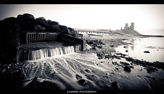 []----------|-| (Kevin HARWIN) Tags: sea england white black beach water misty canon lens eos waterfall kent sand rocks image britain stones south towers picture sigma east 1020mm reculver moveing 70d