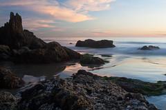 20100102_Corona_del_Mar_0012.jpg (Ryan and Shannon Gutenkunst) Tags: ocean ca sunset sky usa beach water clouds sand rocks waves coronadelmar coronadelmarstatebeach