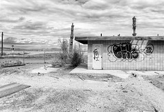 Brawley Avenue (autobahn66.com) Tags: california blackandwhite abandoned clouds graffiti desert decay saltonsea