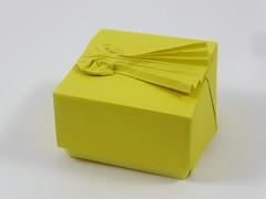 Box with shooting star (Micha Kosmulski) Tags: origami box shootingstar meteor comet bolide fireball star tessellation wetfolding michakosmulski tantpaper yellow