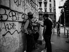 Street trading (DanieleS.) Tags: photo photography shot wow amazing cool great good dannyboy ilovedannyboy daniele salutari street foto fotografia di strada black white bianco nero mono people trade shop shopping urban spring milano milan